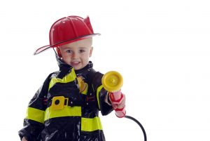 Child dressed as a firefighter